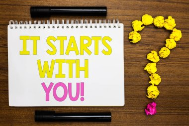 Conceptual hand writing showing It Starts With You. Business photo showcasing Motivation for starting doing something Have discipline White page with bright color word black pen yellow paper lob