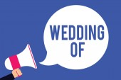 Fotografie Text sign showing Wedding Of. Conceptual photo announcing that man and woman now as married couple forever Man holding megaphone loudspeaker speech bubble screaming blue background.