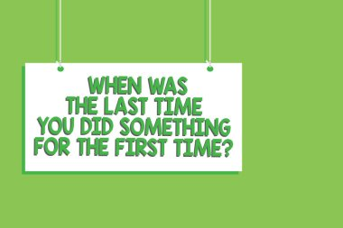 Handwriting text When Was The Last Time You Did Something For The First Time question. Concept meaning 0 Hanging board message communication open close sign green background