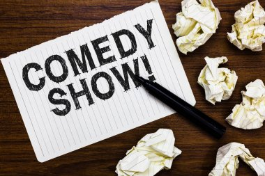 Text sign showing Comedy Show. Conceptual photo Funny program Humorous Amusing medium of Entertainment Marker over notebook crumpled papers ripped pages several tries mistakes