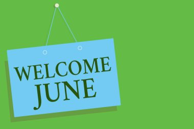 Text sign showing Welcome June. Conceptual photo Calendar Sixth Month Second Quarter Thirty days Greetings Blue board wall message communication open close sign green background.