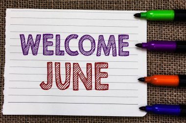 Conceptual hand writing showing Welcome June. Business photo showcasing Calendar Sixth Month Second Quarter Thirty days Greetings Notebook Paper Important reminder Markers Jute background.
