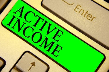 Text sign showing Active Income. Conceptual photo Royalties Salaries Pensions Financial Investments Tips Keyboard green key Intention create computer computing reflection document.