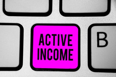 Conceptual hand writing showing Active Income. Business photo text Royalties Salaries Pensions Financial Investments Tips Keyboard purple key Intention create computer reflection document.