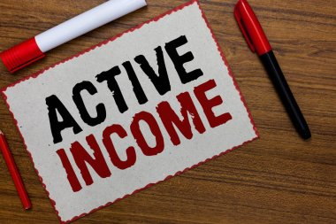 Text sign showing Active Income. Conceptual photo Royalties Salaries Pensions Financial Investments Tips White paper red borders markers wooden background communicating ideas.