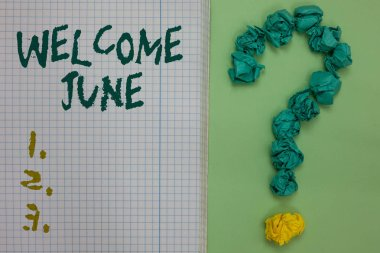 Text sign showing Welcome June. Conceptual photo Calendar Sixth Month Second Quarter Thirty days Greetings Notebook paper crumpled papers forming question mark green background.