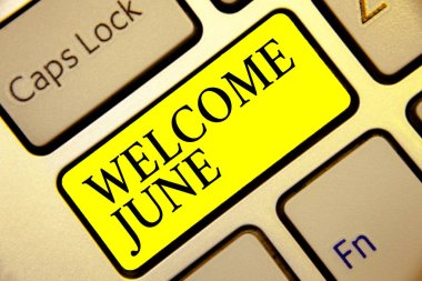 Text sign showing Welcome June. Conceptual photo Calendar Sixth Month Second Quarter Thirty days Greetings Keyboard yellow key Intention create computer computing reflection document.