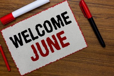 Text sign showing Welcome June. Conceptual photo Calendar Sixth Month Second Quarter Thirty days Greetings White paper red borders markers wooden background communicating ideas.