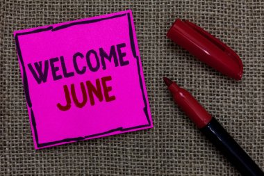 Word writing text Welcome June. Business concept for Calendar Sixth Month Second Quarter Thirty days Greetings Pink paper Important reminder Marker Communicate ideas Jute background.