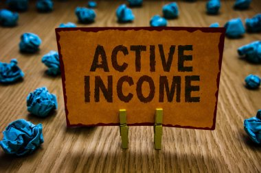 Conceptual hand writing showing Active Income. Business photo text Royalties Salaries Pensions Financial Investments Tips Clothespins holding orange paper note crumpled papers mistake.