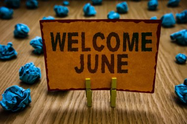 Conceptual hand writing showing Welcome June. Business photo text Calendar Sixth Month Second Quarter Thirty days Greetings Clothespins holding orange paper note crumpled papers mistake.