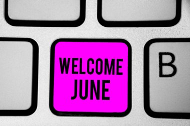 Conceptual hand writing showing Welcome June. Business photo text Calendar Sixth Month Second Quarter Thirty days Greetings Keyboard purple key Intention create computer reflection document.