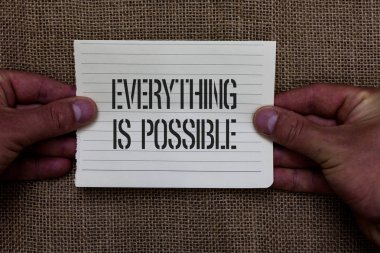 Text sign showing Everything Is Possible. Conceptual photo Any outcome could occur Anything can happen Man holding piece notebook paper jute background Communicating ideas.