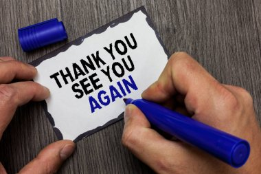 Handwriting text Thank You See You Again. Concept meaning Appreciation Gratitude Thanks I will be back soon Gray wooden deck hand hold black marker written black lined sticky note.