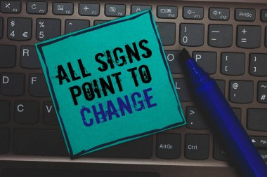 Text sign showing All Signs Point To Change. Conceptual photo Necessity of doing things differently new vision Huge button with computer keyboard black lined written blue page marker pen.