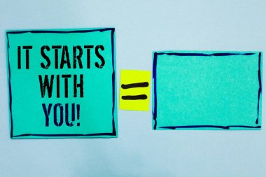 Word writing text It Starts With You. Business concept for Motivation for starting doing something Have discipline Black lined green sticky notes blank and with words mid equal mark.