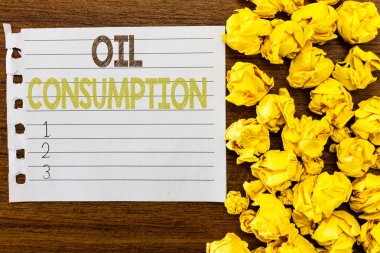 Handwriting text Oil Consumption. Concept meaning This entry is the total oil consumed in barrels per day