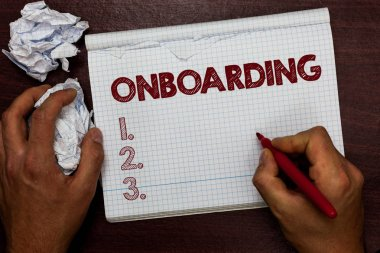 Word writing text Onboarding. Business concept for Action Process of integrating a new employee into an organization Man holding marker notebook page crumpled papers several tries mistakes.