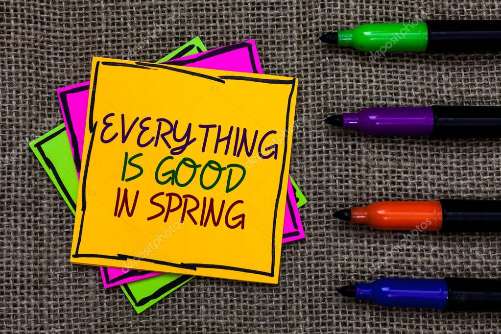 Text sign showing Everything Is Good In Spring. Conceptual photo Happiness for the season Enjoy nature Written on some colorful sticky note 4 pens laid in rank on jute base.