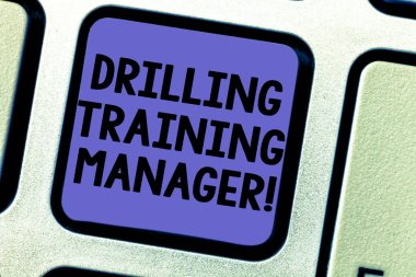 Text sign showing Drilling Training Manager. Conceptual photo Give the staff the understanding drilling process Keyboard key Intention to create computer message pressing keypad idea.
