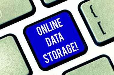Writing note showing Online Data Storage. Business photo showcasing store with third party service accessed via Internet Keyboard key Intention to create computer message pressing keypad idea.
