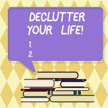 Text sign showing Declutter Your Life. Conceptual photo remove unnecessary items from untidy overcrowded place Uneven Pile of Hardbound Books and Blank Rectangular Color Speech Bubble.
