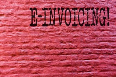 Conceptual hand writing showing E Invoicing. Business photo text Company encourages use of digital billing Brick Wall art like Graffiti motivational call written on the wall.