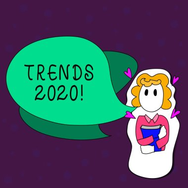 Text sign showing Trends 2020. Conceptual photo general direction in which something is developing or changing Girl Holding Book with Small Hearts Around her and Two Color Speech Bubble.