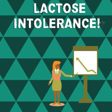 Writing note showing Lactose Intolerance. Business photo showcasing digestive problem where body is unable to digest lactose Woman Holding Stick Pointing to Chart of Arrow on Whiteboard.