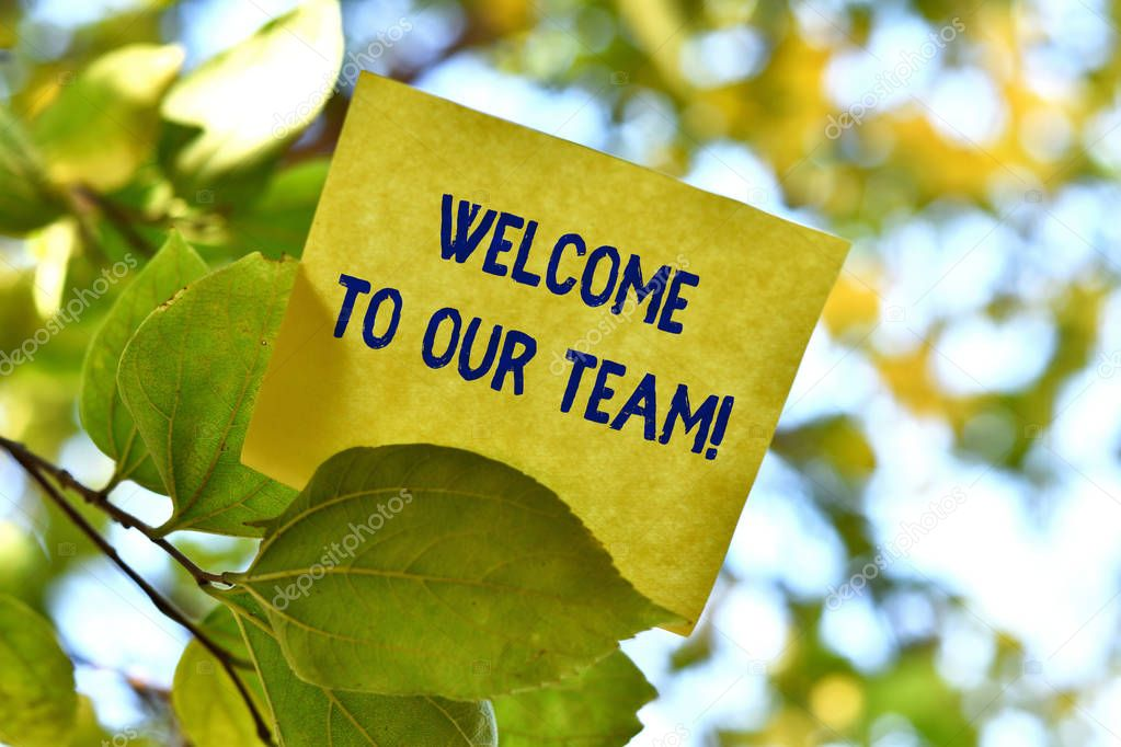 Word writing text Welcome To Our Team. Business concept for introducing another demonstrating to your team mates Piece of square paper use to give notation on tree leaf under sunny day.