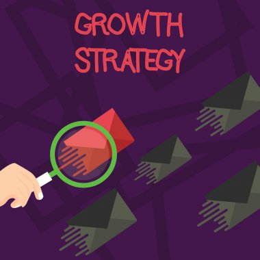 Writing note showing Growth Strategy. Business photo showcasing Strategy aimed at winning larger market share in shortterm Magnifying Glass on Color Envelope and others has Same Shade.