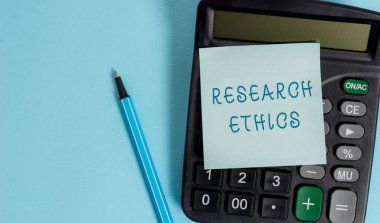 Conceptual hand writing showing Research Ethics. Business photo showcasing interested in the analysis ofethicalissues that raised Electronic calculator sticky note marker colored background.