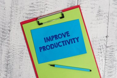 Text sign showing Improve Productivity. Conceptual photo to increase the machine and process efficiency Colored clipboard blank paper sheet marker sticky note wooden background.