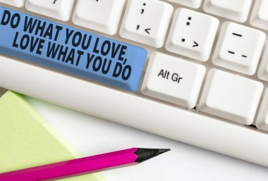 Handwriting text writing Do What You Love Love What You Do. Concept meaning you able doing stuff you enjoy it to work in better places then White pc keyboard with empty note paper above white