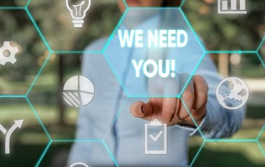 Word writing text We Need You. Business concept for asking someone to work together for certain job or target Female human wear formal work suit presenting presentation use smart device.