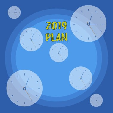 Conceptual hand writing showing 2019 Plan. Business photo showcasing setting up your goals and plans for the current year or in 2019 Different Size Clock Dials against Concentric Circle.