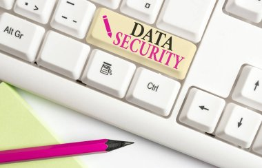 Handwriting text writing Data Security. Concept meaning Confidentiality Disk Encryption Backups Password Shielding White pc keyboard with empty note paper above white background key copy space.