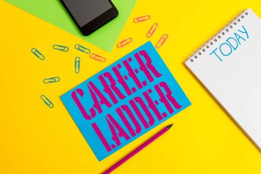 Word writing text Career Ladder. Business concept for Job Promotion Professional Progress Upward Mobility Achiever Blank spiral notepad pencil clips smartphone paper sheets color background.