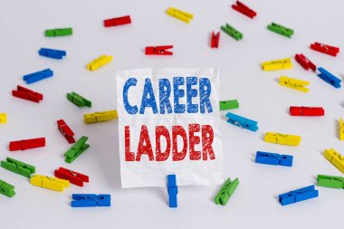 Text sign showing Career Ladder. Conceptual photo Job Promotion Professional Progress Upward Mobility Achiever Colored clothespin papers empty reminder white floor background office.