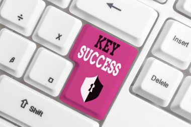 Text sign showing Key Success. Conceptual photo generally three to five areas that company may focus on White pc keyboard with empty note paper above white background key copy space.