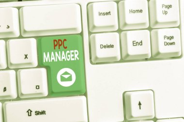Word writing text Ppc Manager. Business concept for which advertisers pay fee each time one of their ads is clicked White pc keyboard with empty note paper above white background key copy space.