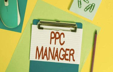 Word writing text Ppc Manager. Business concept for which advertisers pay fee each time one of their ads is clicked Clipboard striped sheets marker clips notepad mouse colored background.