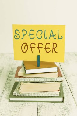 Conceptual hand writing showing Special Offer. Business photo showcasing Discounted price Markdown Promotional Items Crazy Sale pile stacked books notebook pin color reminder white wooden.