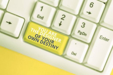 Writing note showing You Are The Designer Of Your Own Destiny. Business photo showcasing Embrace life Make changes White pc keyboard with note paper above the white background.
