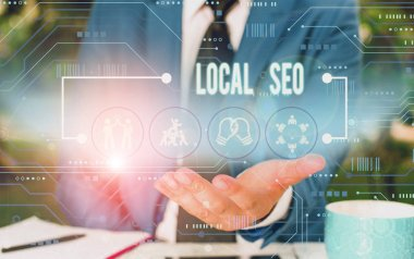 Text sign showing Local Seo. Conceptual photo This is an effective way of marketing your business online Male human wear formal work suit presenting presentation using smart device.
