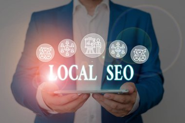 Writing note showing Local Seo. Business photo showcasing This is an effective way of marketing your business online Male wear formal work suit presenting presentation smart device.