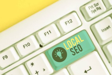 Conceptual hand writing showing Local Seo. Business photo showcasing This is an effective way of marketing your business online White pc keyboard with note paper above the white background.
