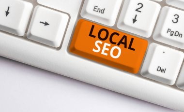 Writing note showing Local Seo. Business photo showcasing This is an effective way of marketing your business online White pc keyboard with note paper above the white background.