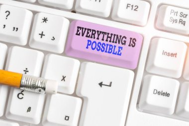 Word writing text Everything Is Possible. Business concept for Any outcome could occur Anything can happen White pc keyboard with empty note paper above white background key copy space.