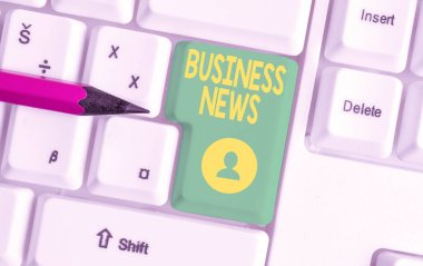 Writing note showing Business News. Business photo showcasing Commercial Notice Trade Report Market Update Corporate Insight White pc keyboard with note paper above the white background.